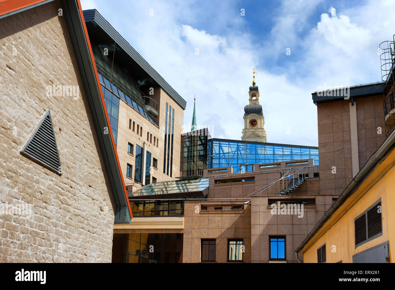 Urban unusual view of the building of the Riga Town Hall with a tower and a clock and a courtyard - Stock Image