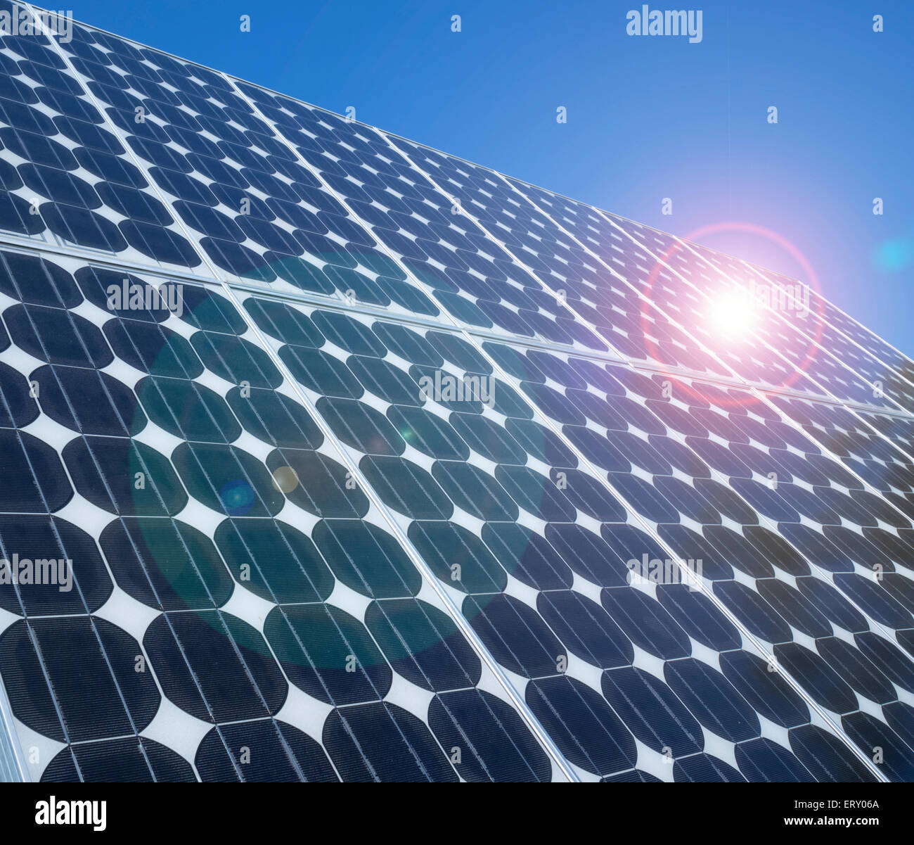 photovoltaic-cells-array-close-up-blue-lens-flare-sunlight-reflection-ERY06A.jpg
