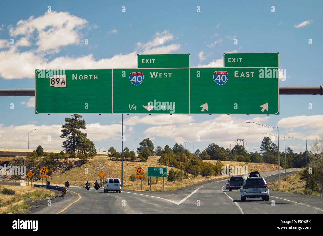Blank empty freeway signs on western US highway copy space for your text messages. Use News MT Gothic Bold to match Stock Photo