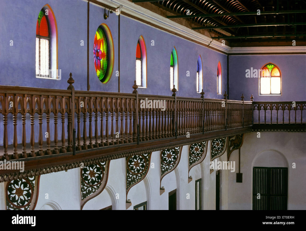 ornately railed corridor runs hall height protects access array painted windows stream Chettinad Tamil Nadu - Stock Image