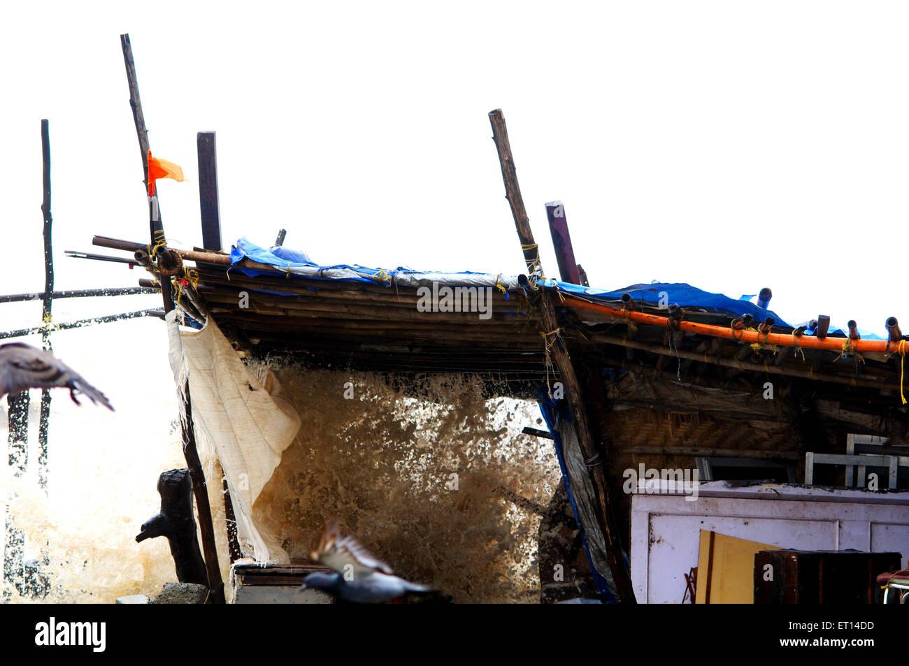 sea waves high tide destruction mumbai India - Stock Image