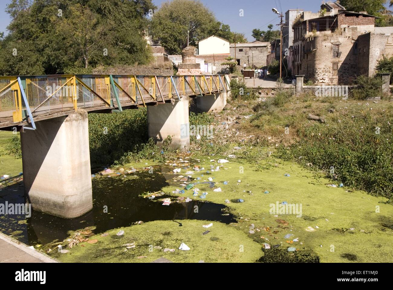 Pollution river turns into garbage dump people throw rubbish river karh Sasvad village taluka Purandar Pune maharashtra - Stock Image