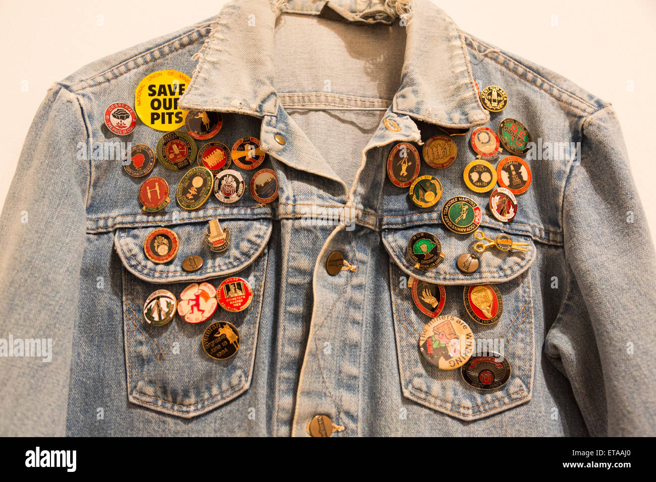 London, UK. 8 June 2015. Pictured: a jeans jacket with memorabilia badges. The Battle of Orgreave Archive (An Injury - Stock Image