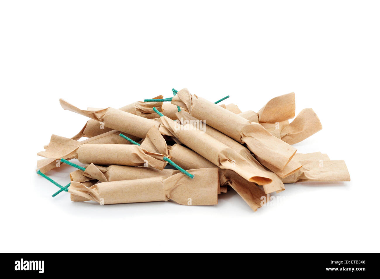 some brown firecrackers with green fuse on a white background - Stock Image