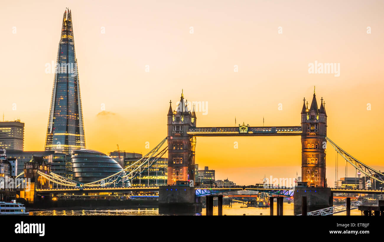 The new London skyline with Tower Bridge and the new The Shard skyscraper at Dusk. Stock Photo