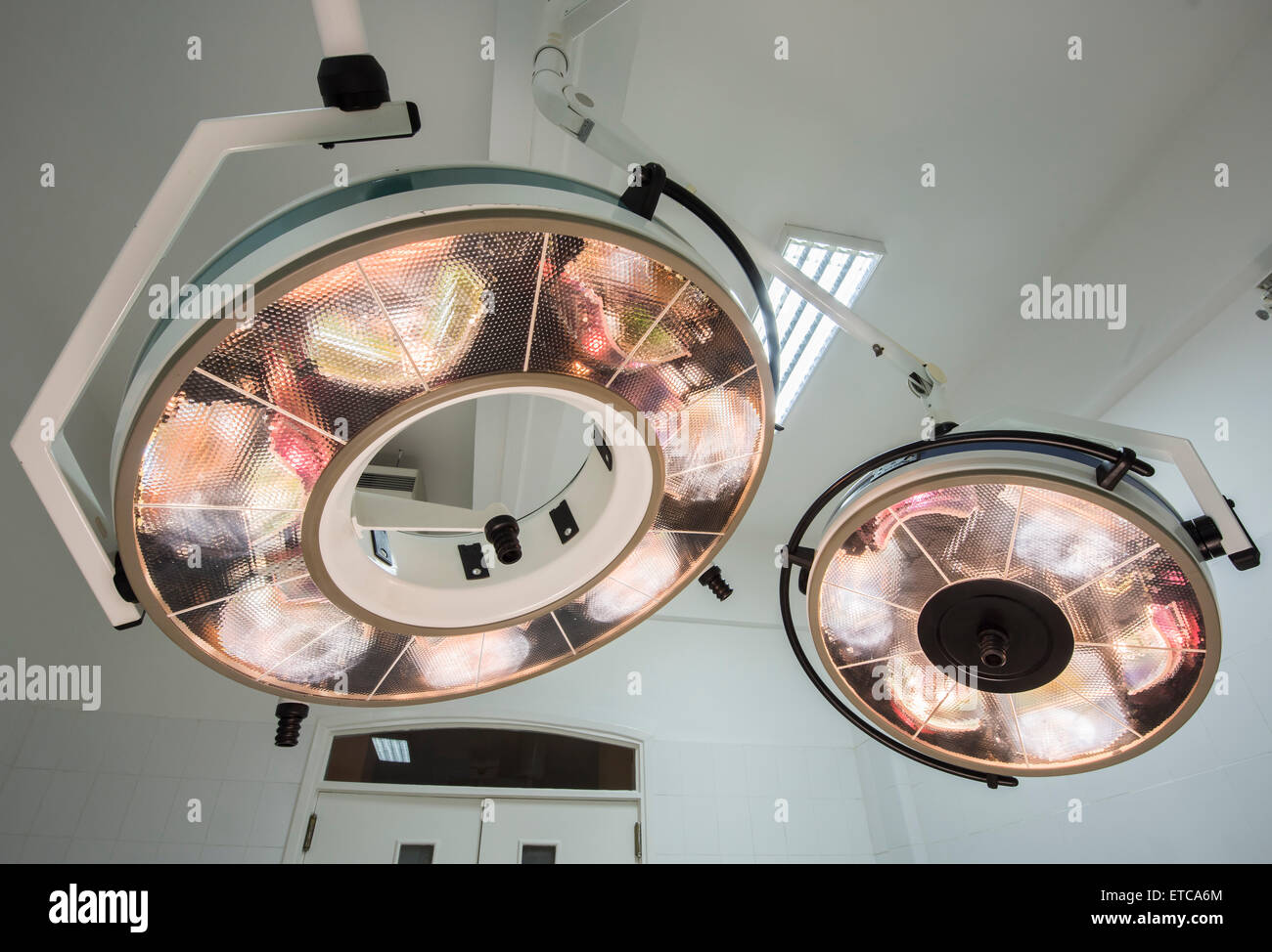 High powered circular surgery lights in a hospital operating room - Stock Image