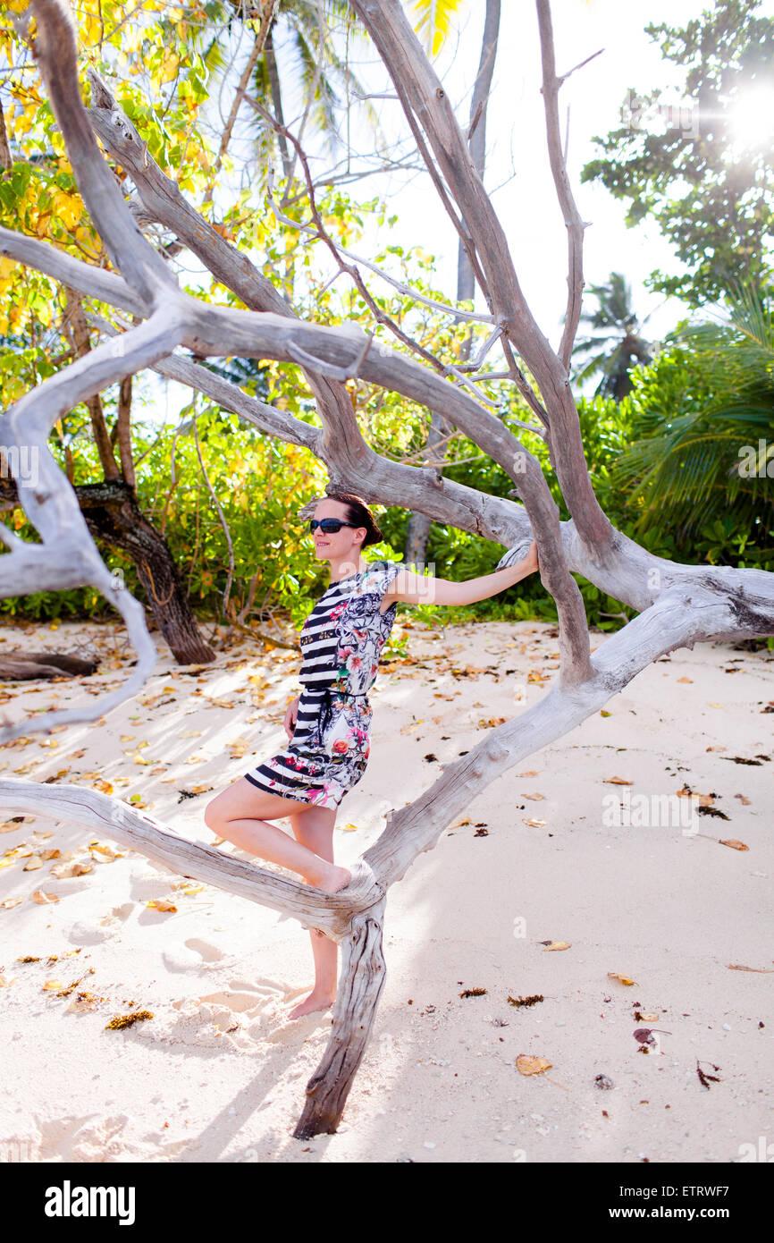 European woman, Seychelles, Praslin, beach photo shooting, sunrise, fashion - Stock Image