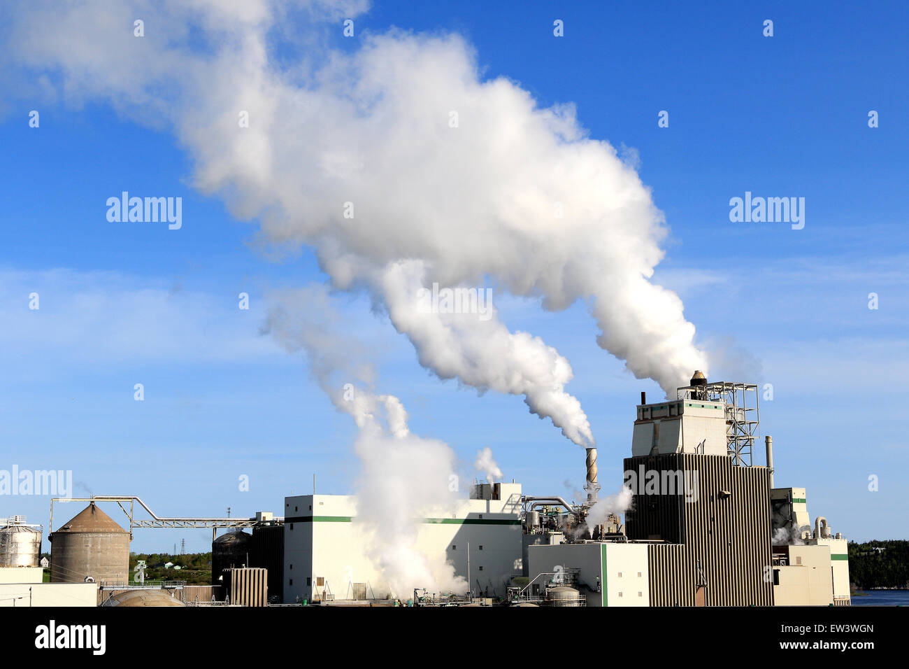 Smoke from factory releases air pollution and greenhouse gases. - Stock Image