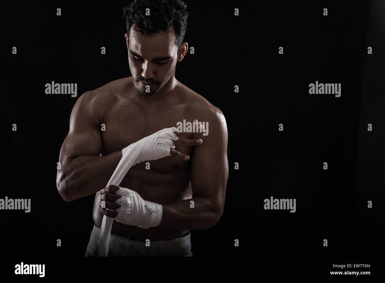 Man getting ready for boxing practice - Stock Image