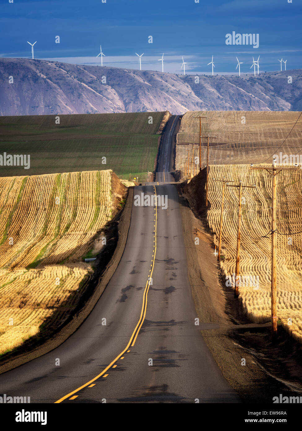 Back road and wind turbines in Sherman County near the Columbia River Gorge, Oregon - Stock Image
