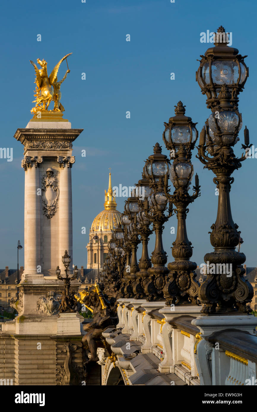 The ornate Pont Alexandre III with Hotel les Invalides beyond, Paris, France - Stock Image