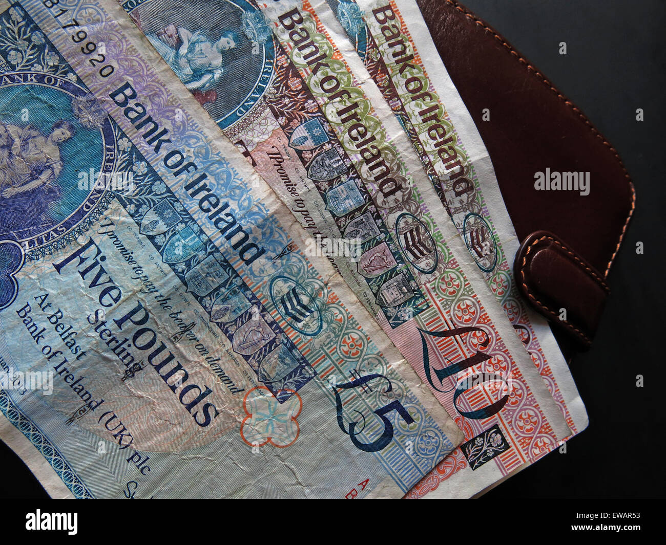 Note,Eire,republic,of,coin,Sterling,legal tender,from the,Bank Of Ireland,Belfast,bank,of,Ireland,region,regional,economy,economic,money,monetary,union,UK,United Kingdom,housekeeping,good,bad,currency,wealth,capital,worth,rich,wealthy,fund,funds,ready money,hard cash,ten,five,fiver,wallet,next,GoTonySmith,legal,tender,small,smallest,banks,Europe,european,GB,Great Britain,Great Britain,EC,EU,EEC,hard,cash,ready,Derry,Londonderry,DUP,Sinn Fein,politics,political,tenner,twentypence,twenty,pence,banknote,billetes,bureau,business,buy,buying,caja,change,commerce,commercialism,capitalism,austerity,global,crash,global crash,cuenta,debt,dinero,dollar,enterprise,euro,exchange,export,exporting,global,globalization,historical,history,monetary,negocio,number,paper,paper money,folding,power,saving,spending,profit,prosperity,prosperous,queen,rate,spend,spending,system,trade,viajar,vintage,wealth,world,bailout,bail out,bail,out,six counties,6,six,county,counties,to,a,next to a wallet,brown,Buy Pictures of,Buy Images Of