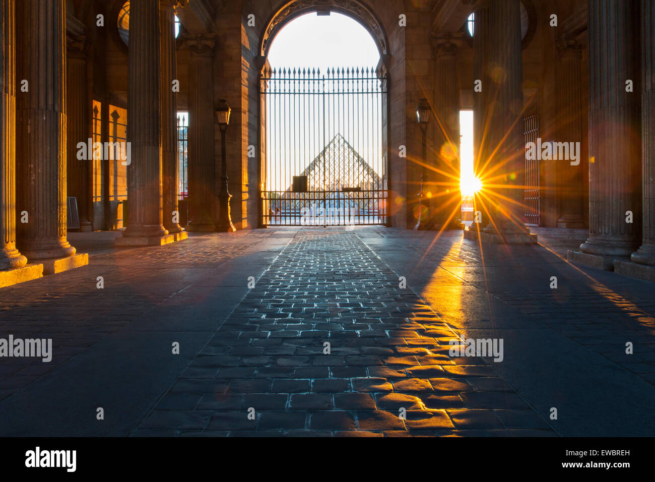 Sunset at gated entry to Musee du Louvre, Paris, France - Stock Image