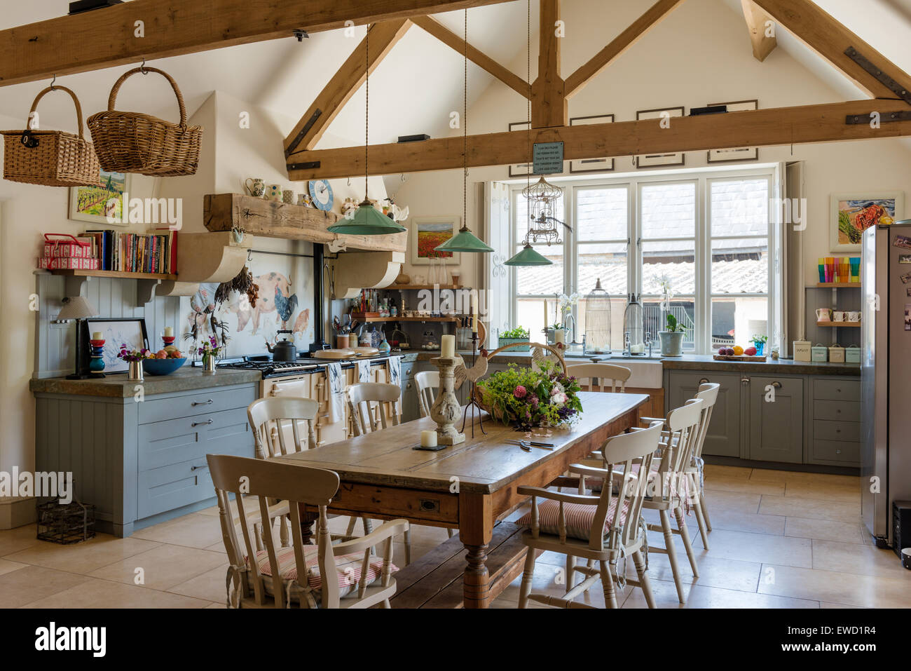 Vintage farmhouse table in rustic kitchen with green pendant ...