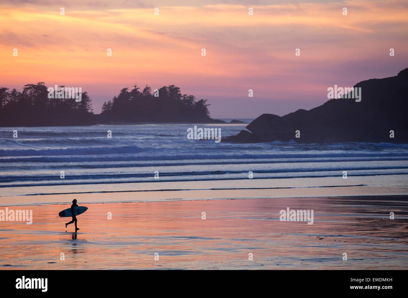 f883eebd1c Surfer at sunset on Cox Bay Beach