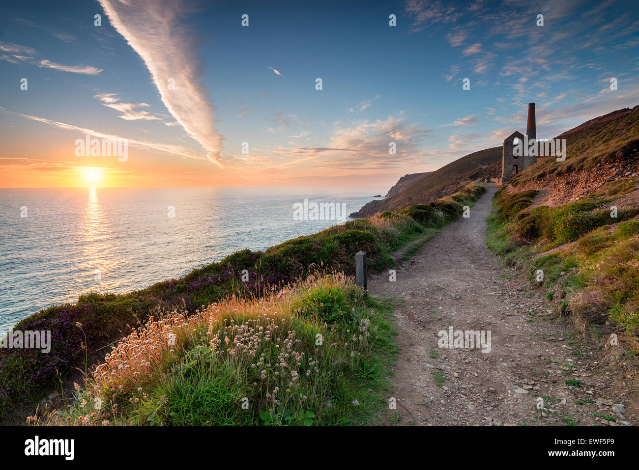 Sunset from the South West Coast Path as it passes the Towanroath engine house and leads toward St Agnes Head on - Stock Image
