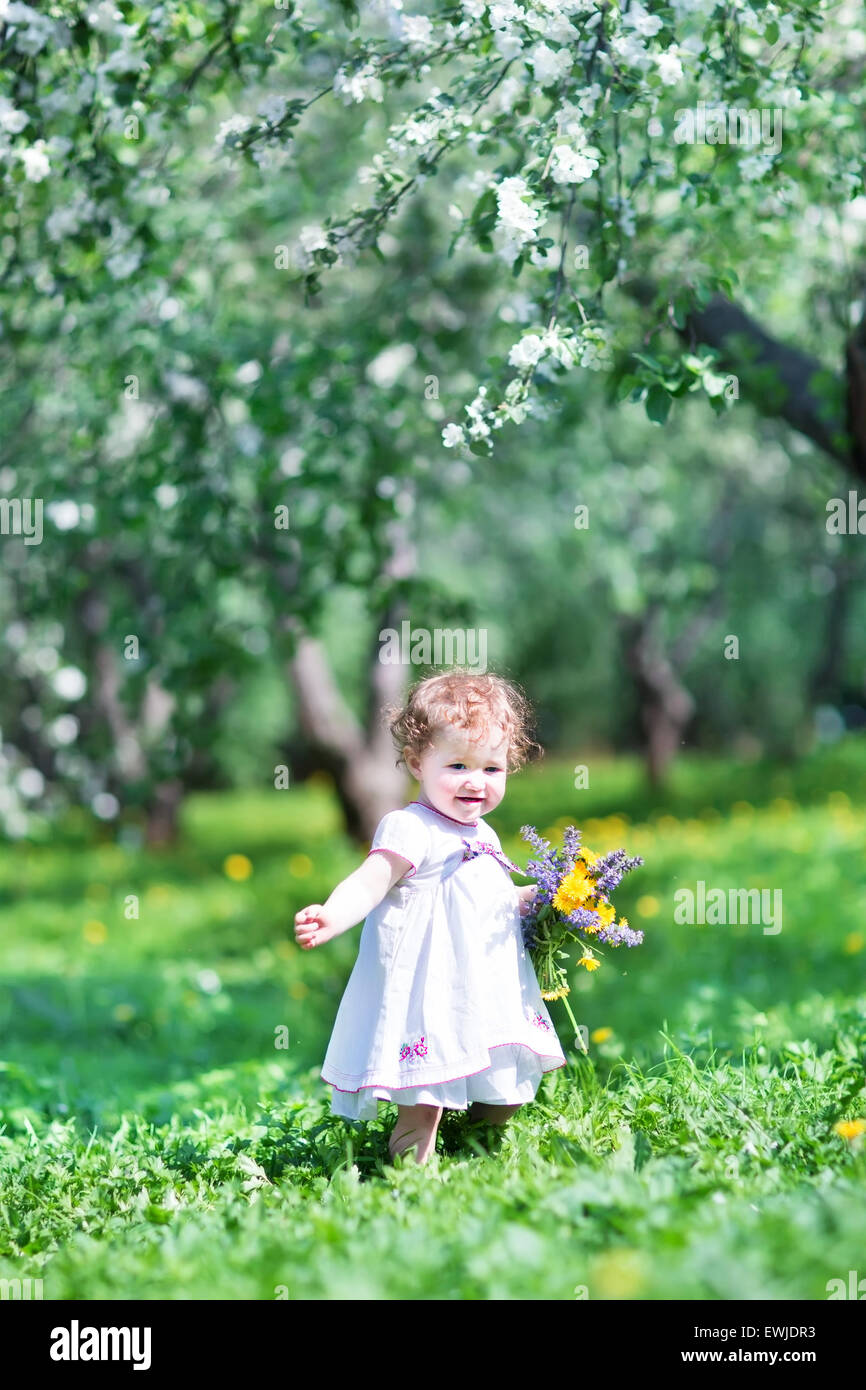 sweet baby girl playing with beautiful flowers - Sweet Baby Girl