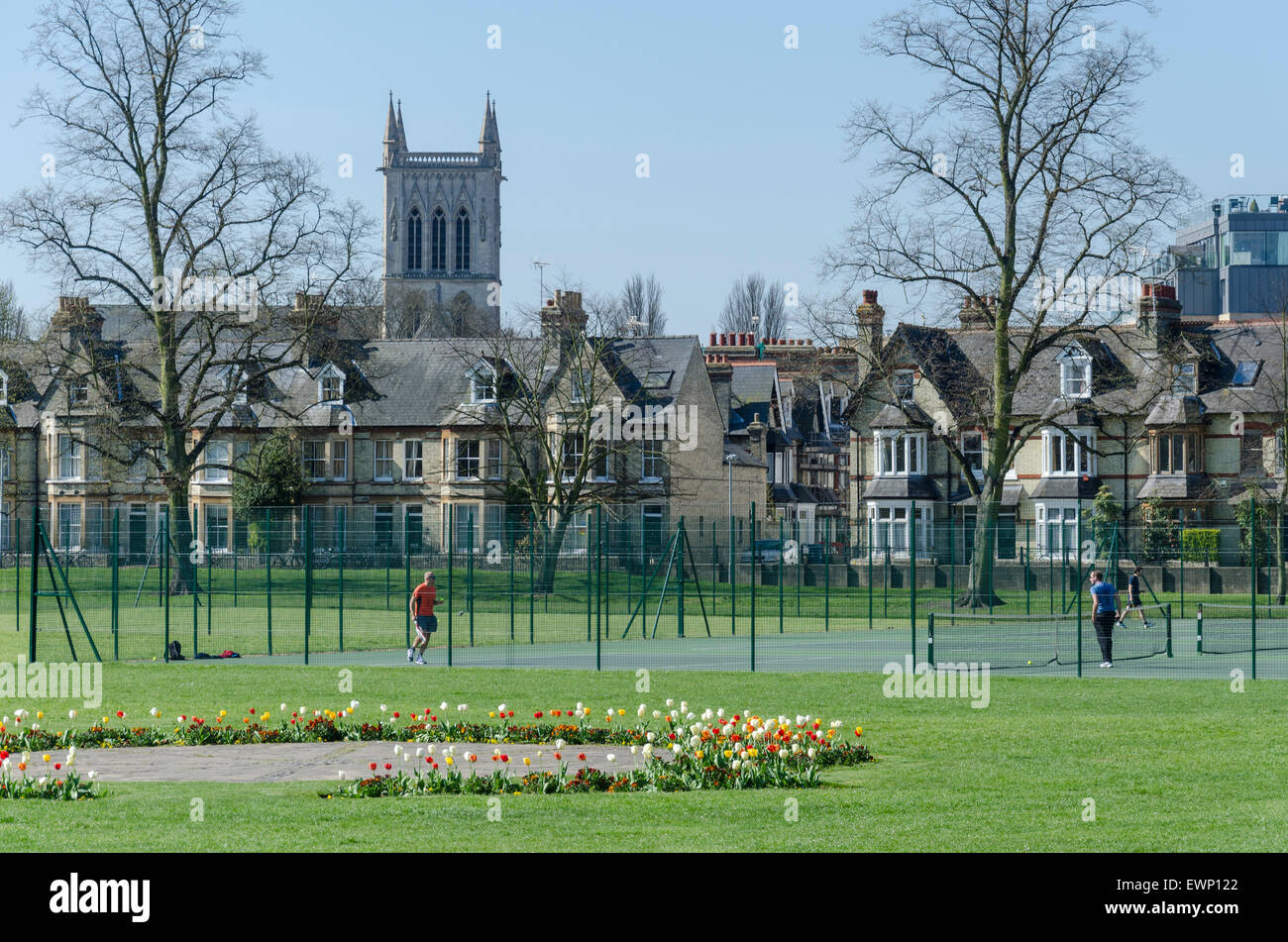 People playing tennis at the public tennis courts on Jesus Green, Cambridge, UK - Stock Image