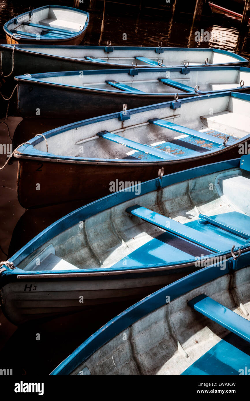 several rowing boats in the water - Stock Image