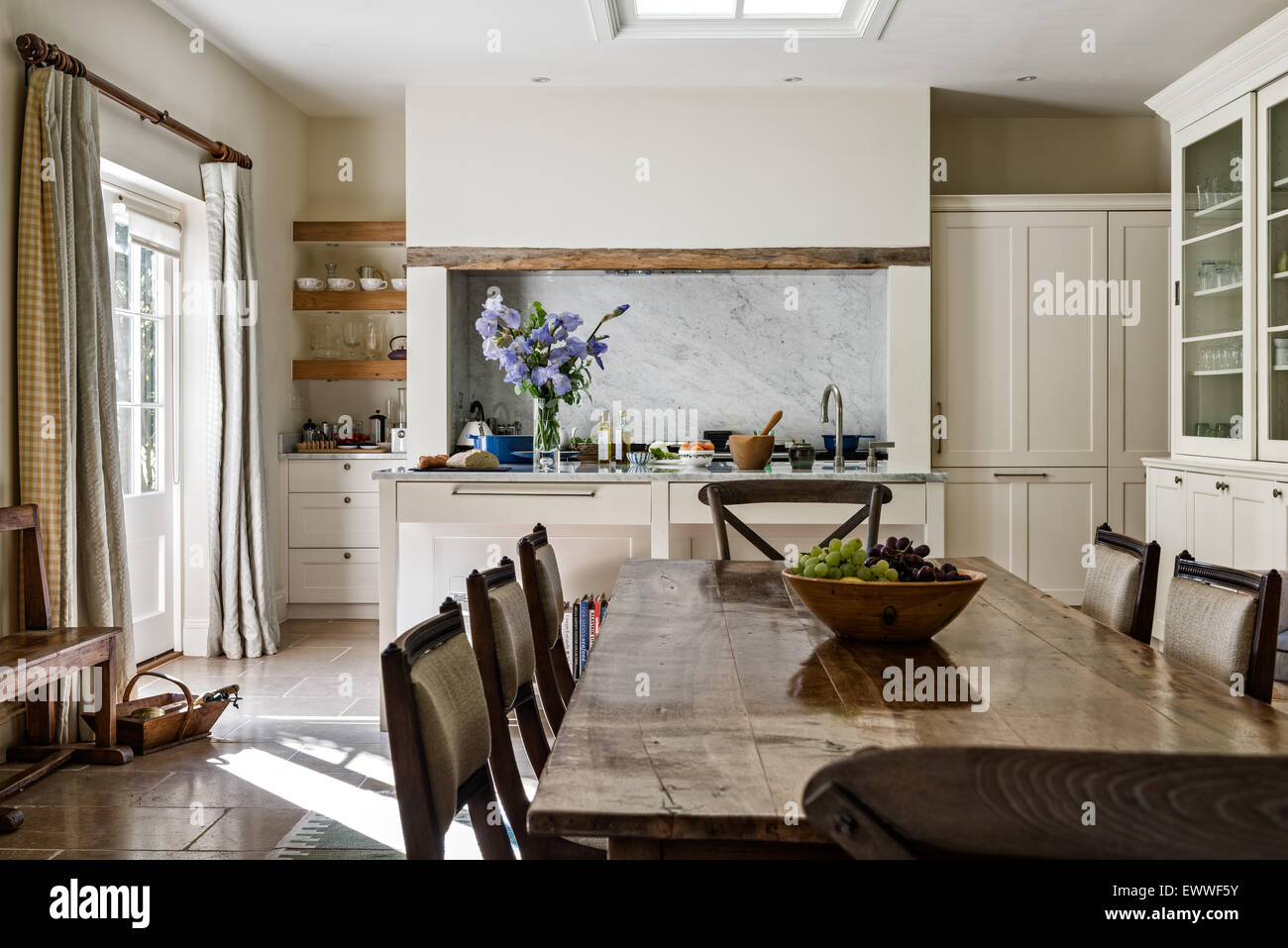 Antique dining table with chairs in open plan kitchen dining room antique dining table with chairs in open plan kitchen dining room with limestone flooring dzzzfo
