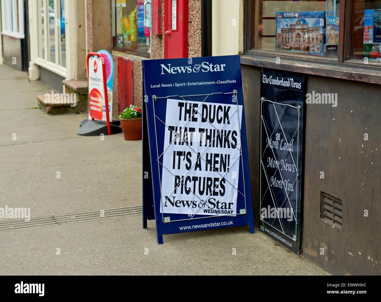 newspaper-headline-on-sign-outside-newsagent-shop-england-uk-EWWHNC.jpg