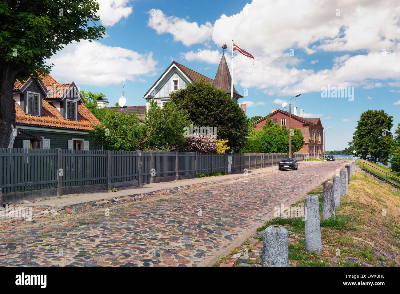 Latvia, Riga, Kipsala. June 2015. Old houses with the national flag in the historic city of Riga on the left bank - Stock Image