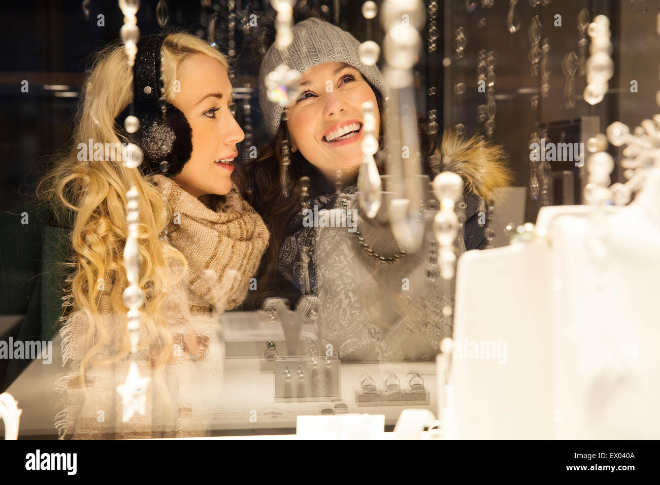 Two mid adult women window shopping - Stock Image