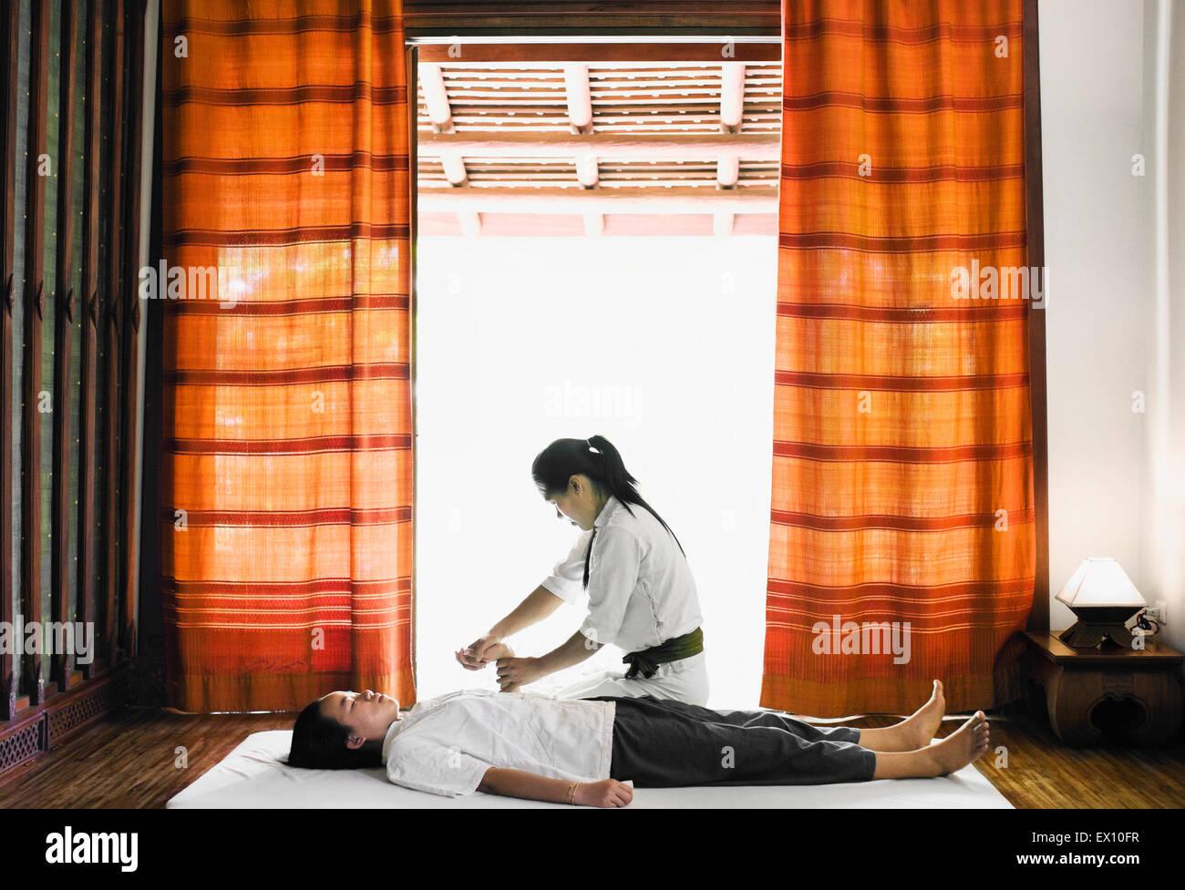 Sip Sen, or traditional Lao Massage at The Spa at La Residence Phou Vao, Luang Prabang, Laos. - Stock Image