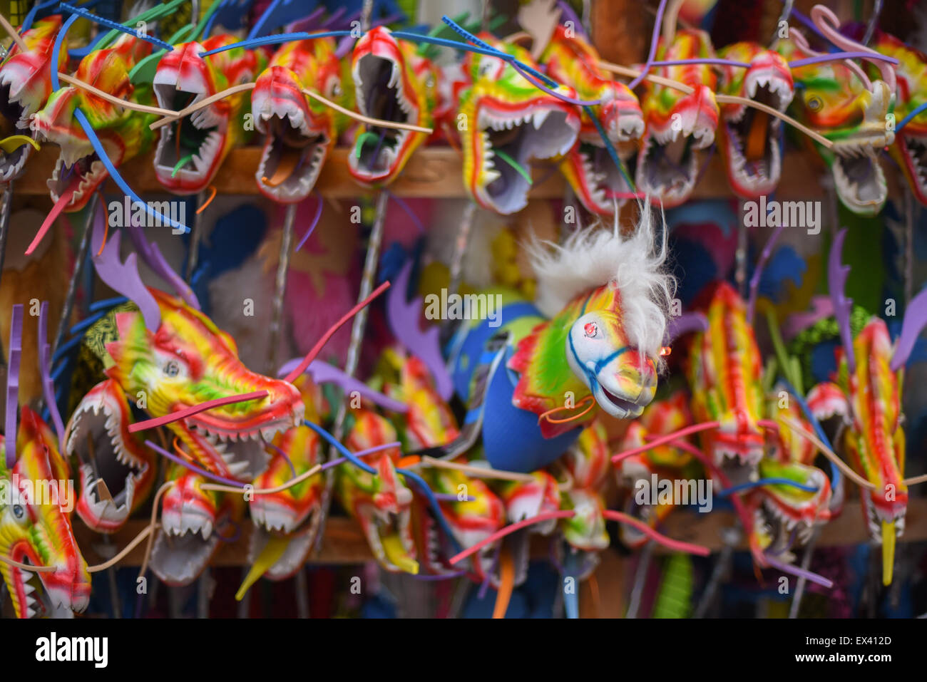 Dragon-like toys at a street vendor during the Lunar New Year celebration in Bandung, Indonesia. - Stock Image
