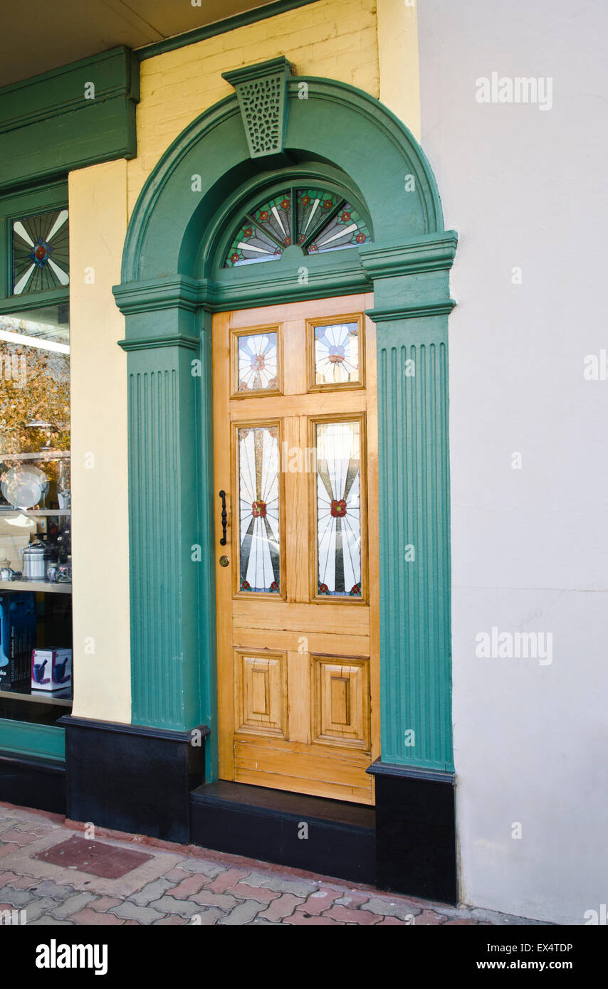 Multi Paneled Timber And Glass Front Door With Transom Light And