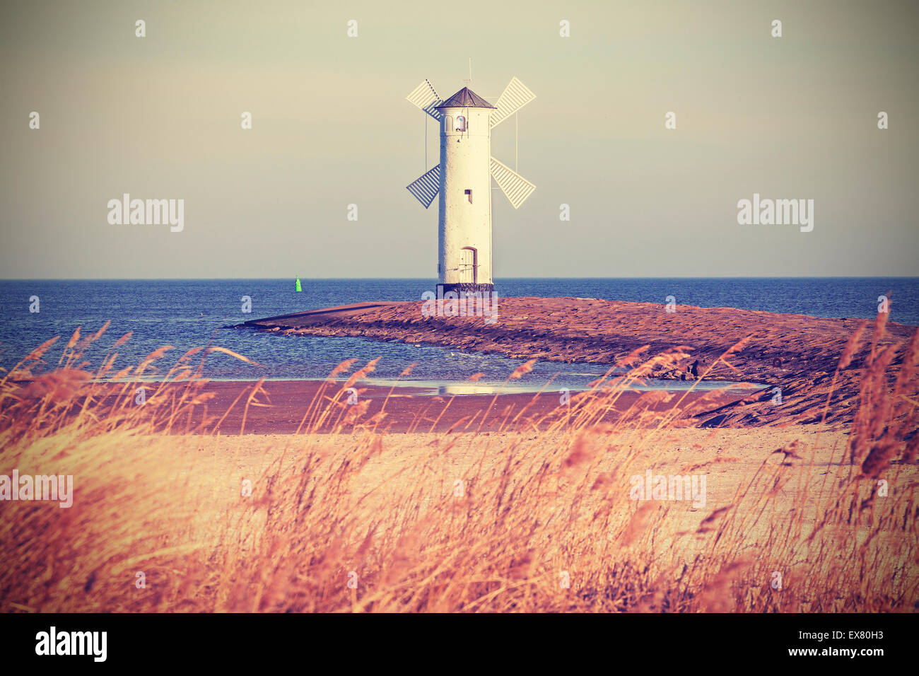Retro vintage stylized lighthouse, Swinoujscie in Poland. - Stock Image