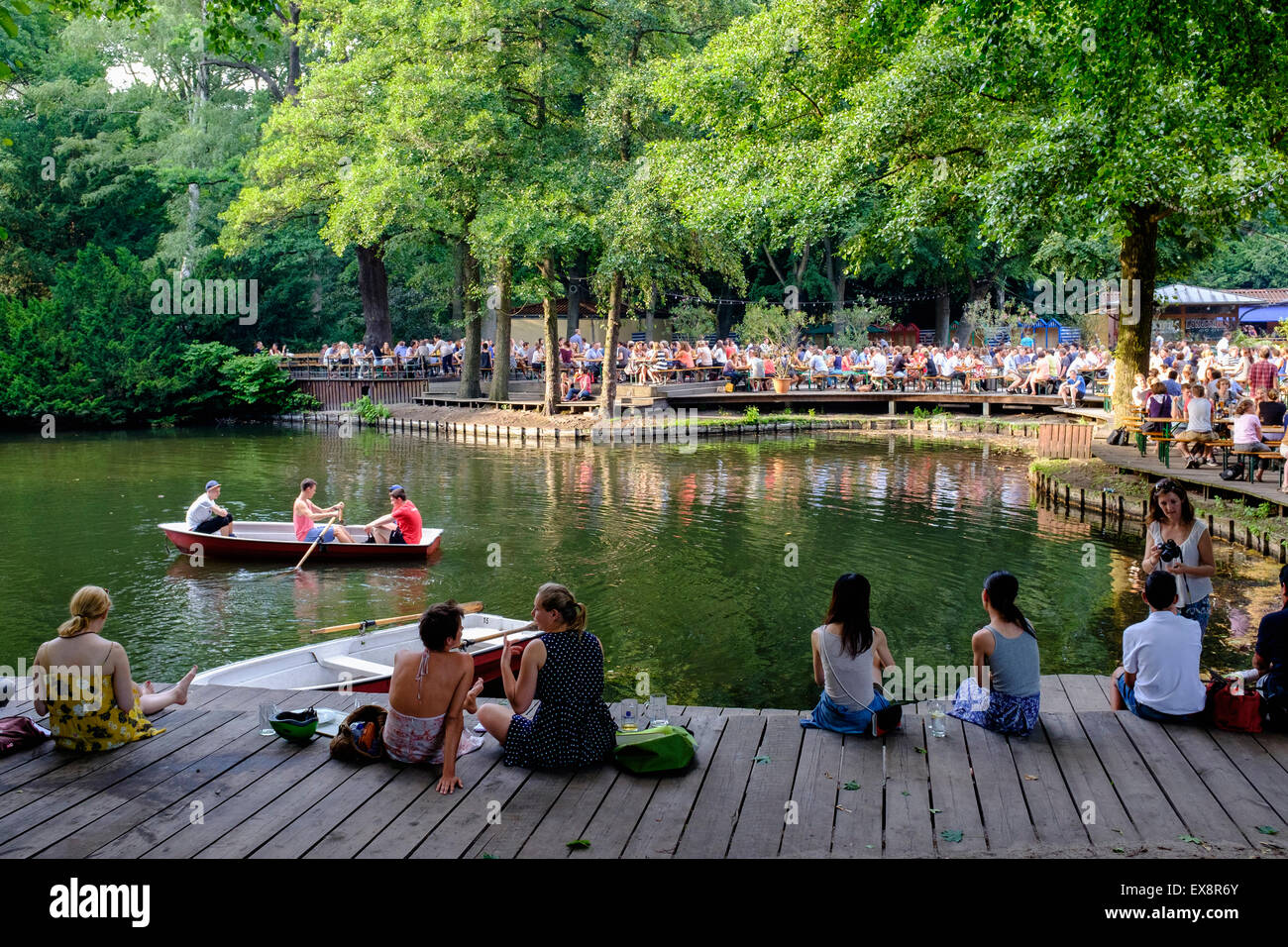 Busy beer garden in summer at Cafe am Neuen See in Tiergarten park in Berlin Germany Stock Photo