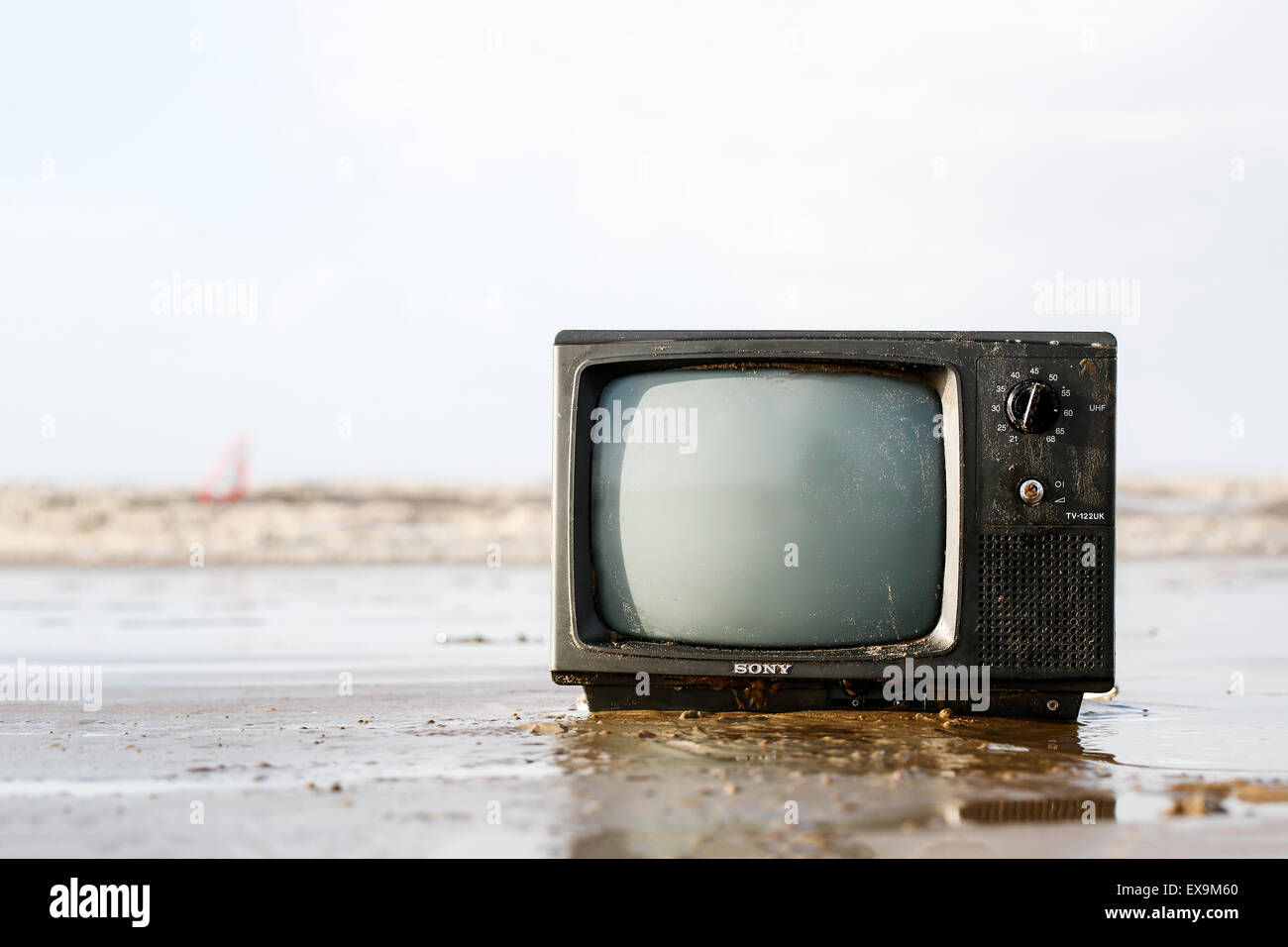 an-old-tv-washed-up-out-of-the-sea-onto-