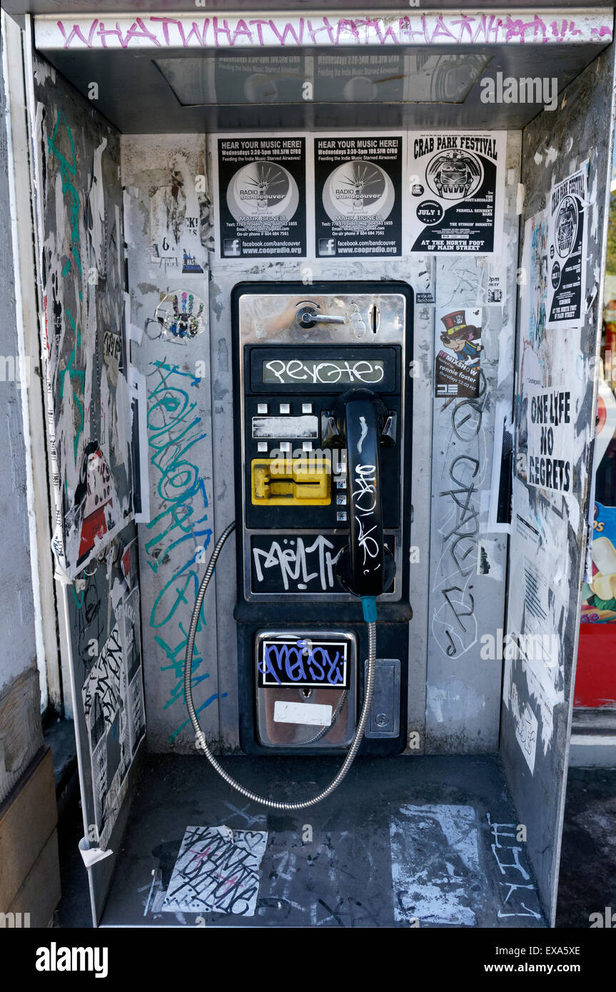 old-coin-operated-payphone-covered-in-gr