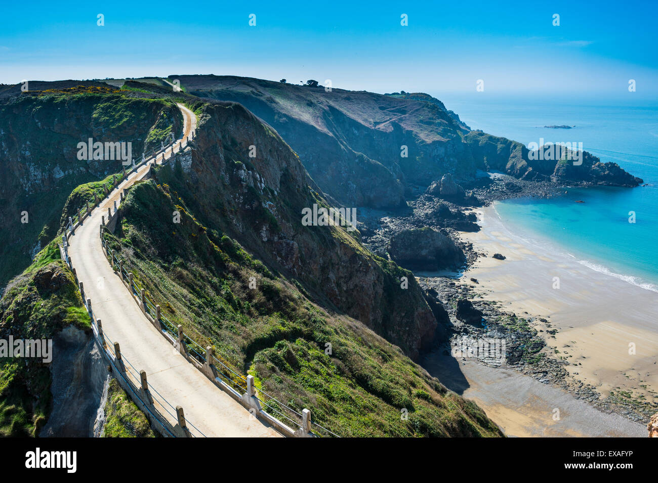 Road connecting the narrow isthmus of Greater and Little Sark, Channel Islands, United Kingdom, Europe - Stock Image