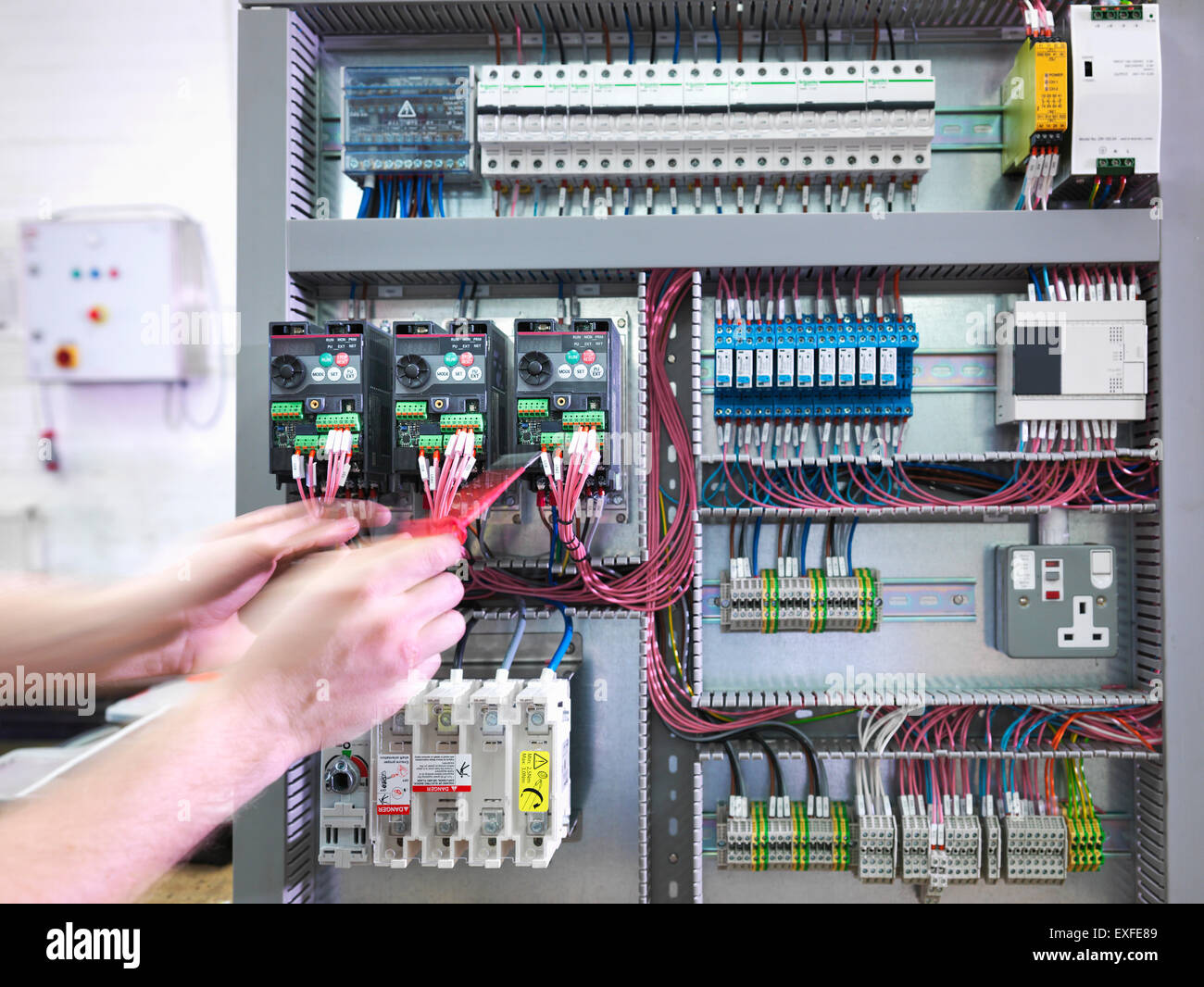 Electrical Wiring Test Board Ask Answer Diagram Questions Hands Of Engineer Testing Switch In Engineering Rh Alamy Com