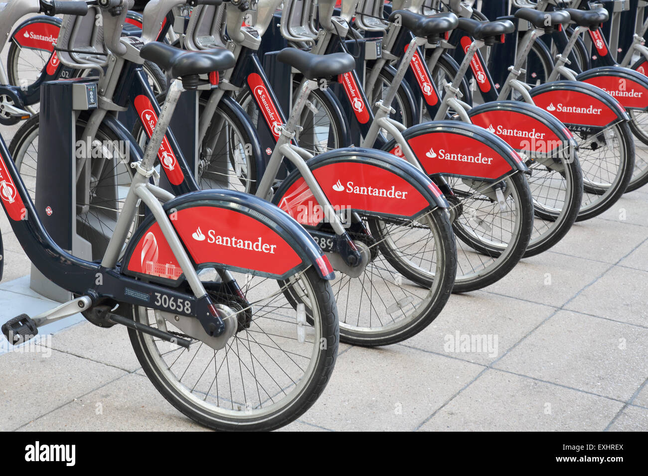 santander sponsored bikes for hire at canary wharf in london Stock Photo