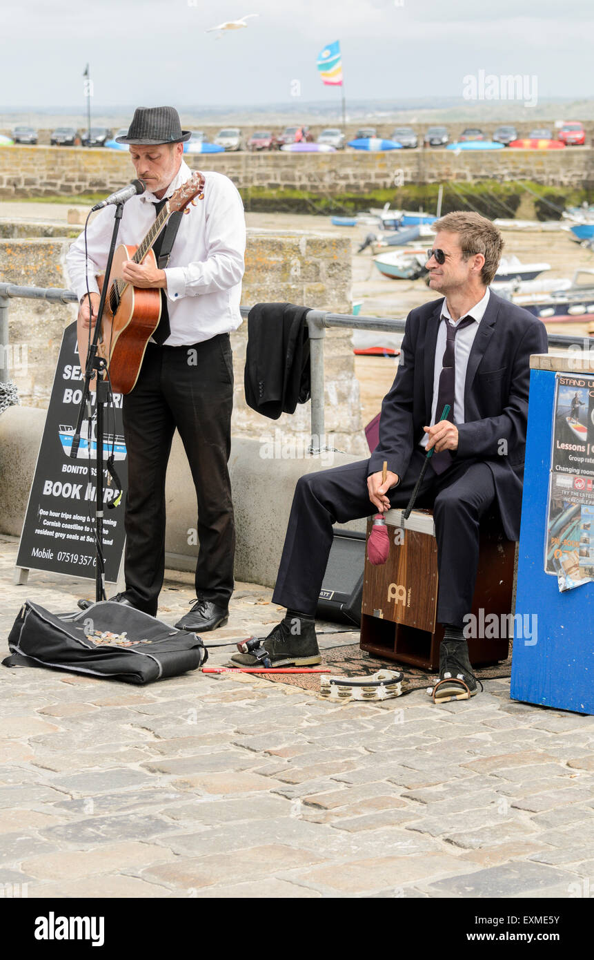 Buskers playing on The Wharf, St Ives, Cornwall, England, U.K. - Stock Image
