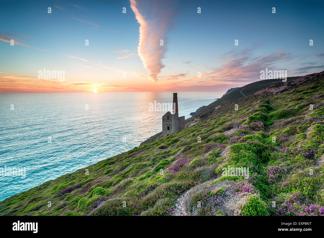 Sunset on the Cornwall coast at St Agnes looking out over the Towanroath engine house - Stock Image