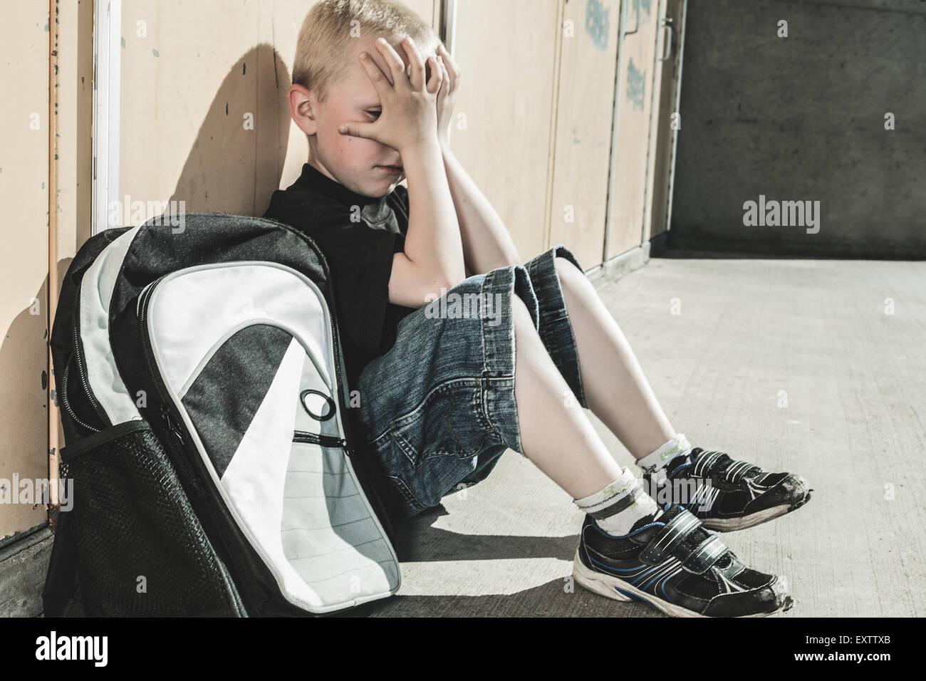 a very sad boy in school playground stock photo 85368931 alamy
