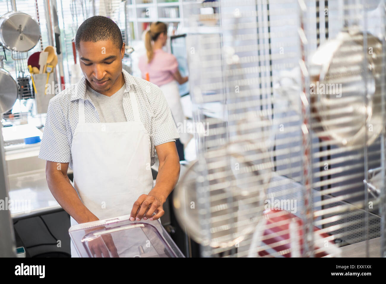 Bakery owner at work - Stock Image