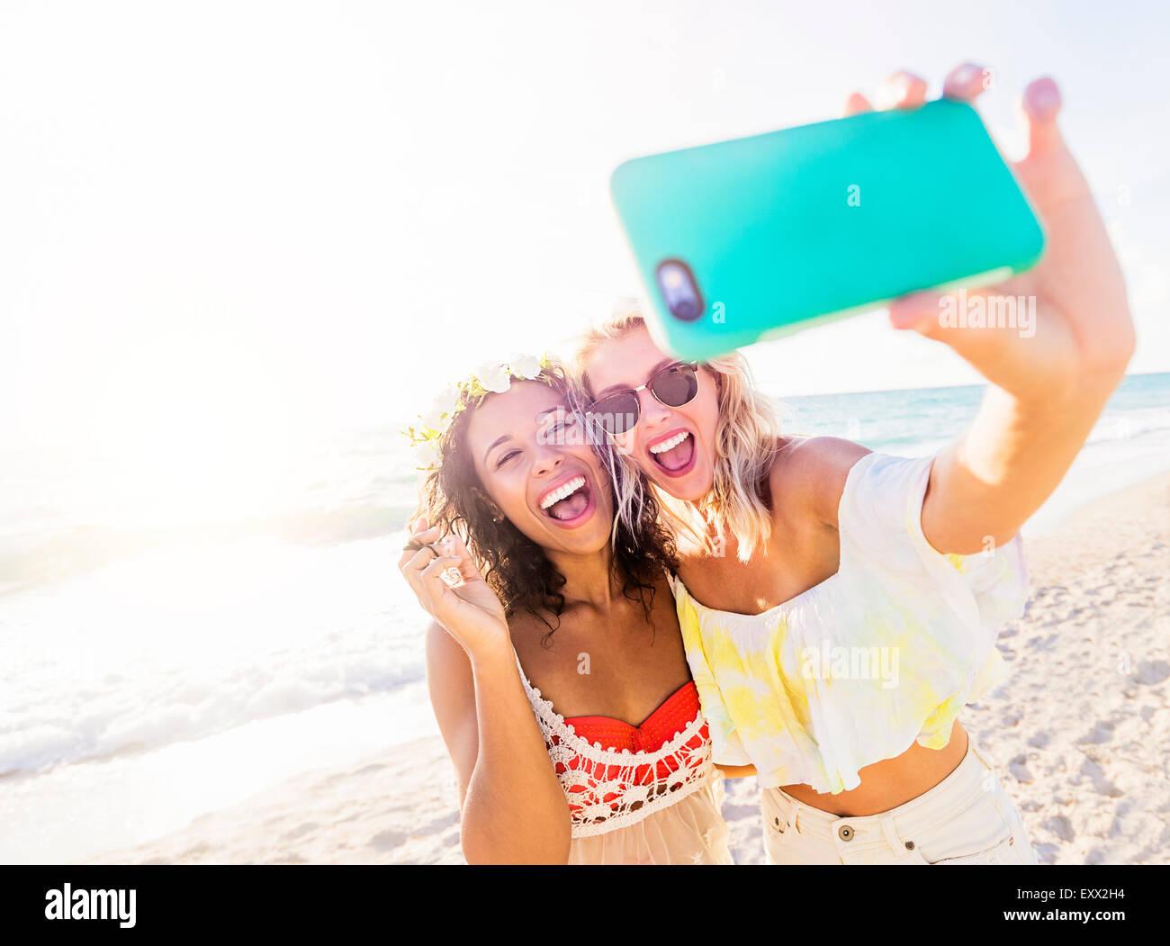 Female friends on beach - Stock Image