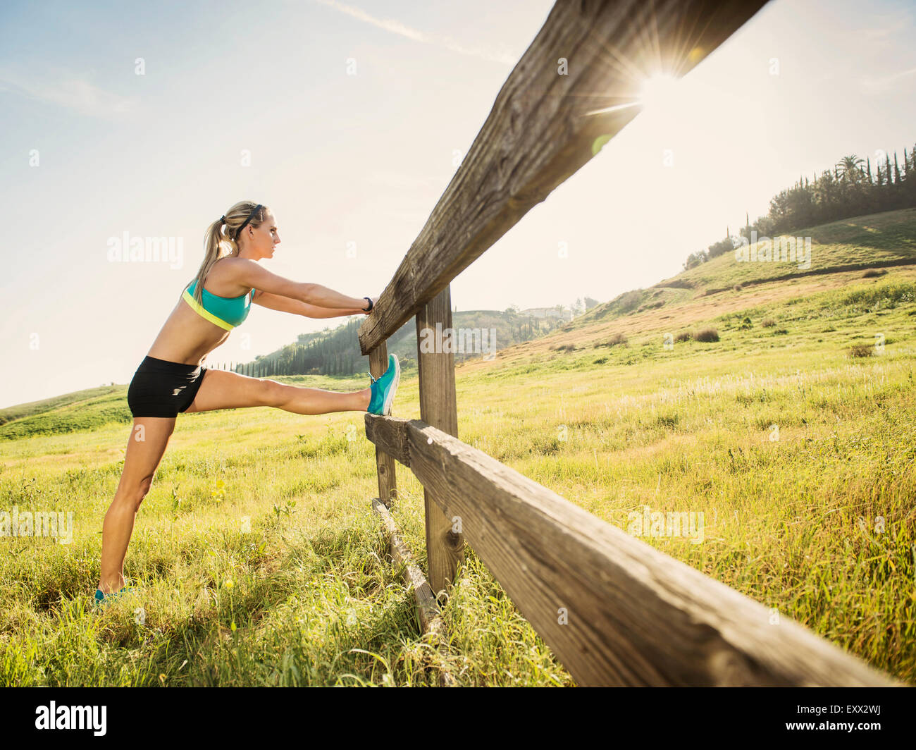 Woman stretching outdoors - Stock Image