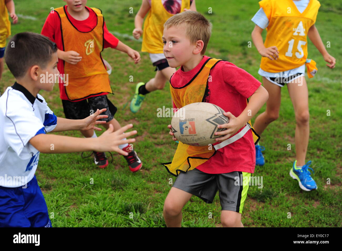 Sports youth rugby played in the USA in Virginia - children 9 10 11 12 girls boys practice together Stock Photo