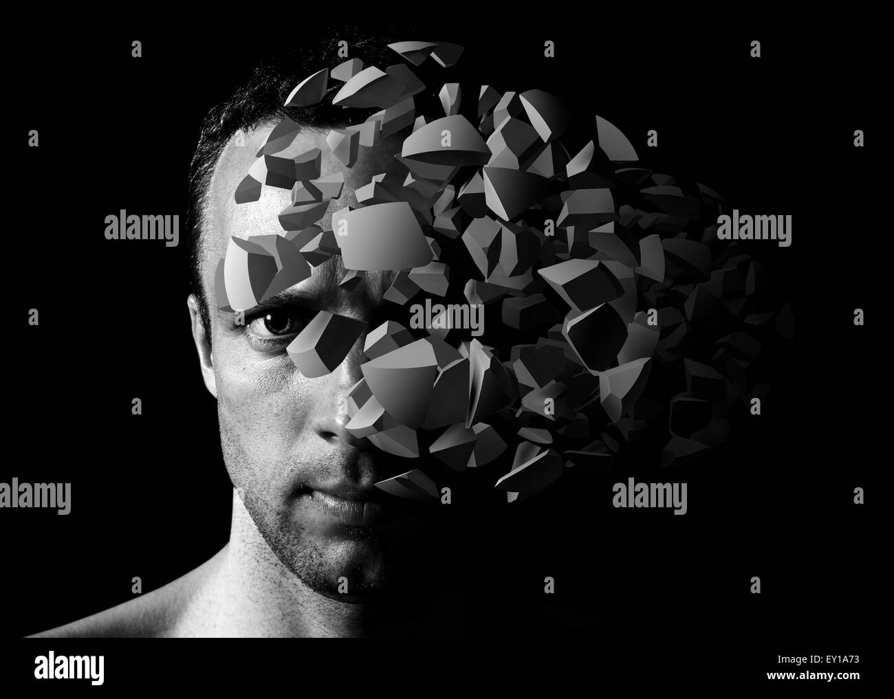 Caucasian young man creative portrait with 3d explosion fragments on black background - Stock Image