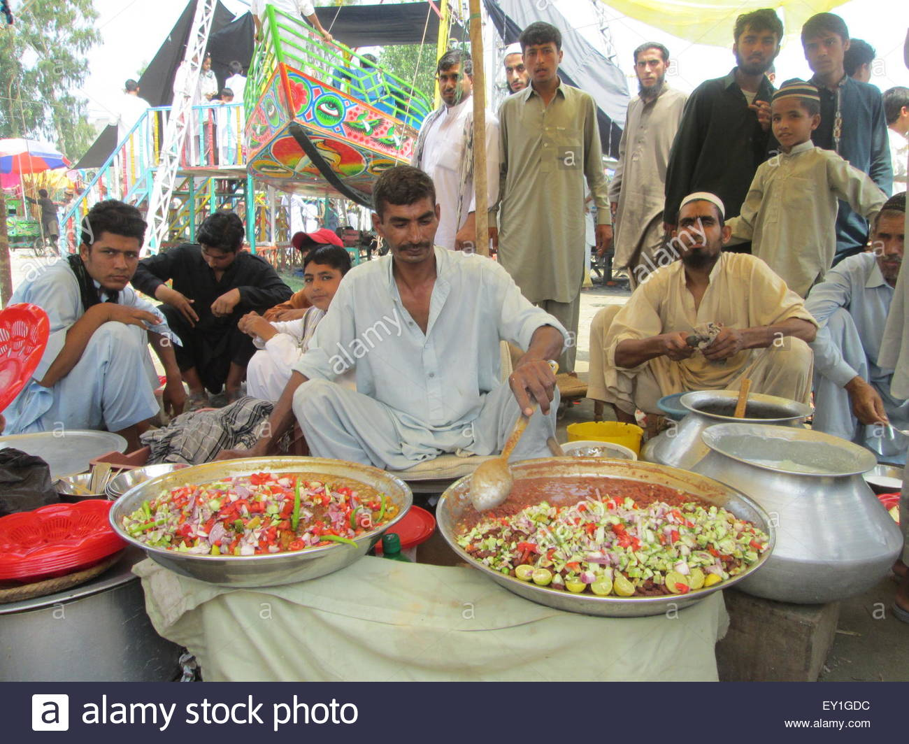 Wonderful Pakistani Eid Al-Fitr Feast - charsadda-pakistan-july-19th-2015-vendors-sell-food-as-eid-al-fitr-EY1GDC  Snapshot_568060 .jpg