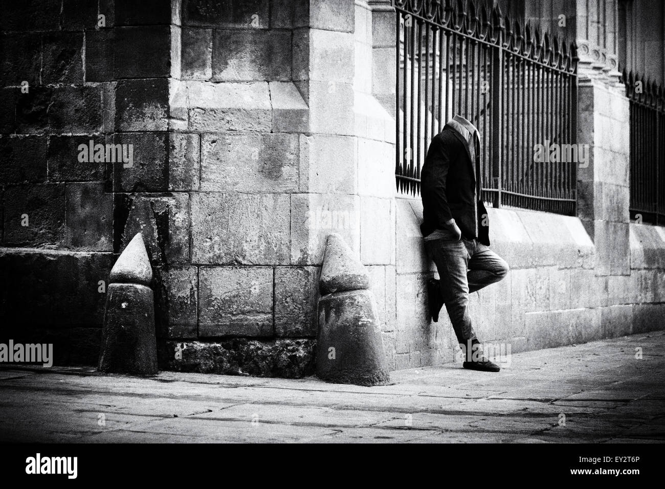 black-white-image-of-headless-street-performer-by-the-cathedral-gothic-EY2T6P.jpg