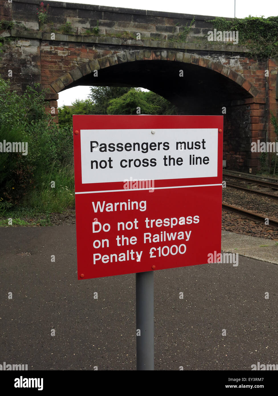 red,british rail,railtrack,rail,track,Scotrail,platform,Annan,station,warning,do not trespass,penalty,£1000,£1,000,England,English,Scottish,Scotland,bridge,safety,health,H&S,Health and Safety,privatised,franchise,Passengers must not cross the line,GoTonySmith,Buy Pictures of,Buy Images Of