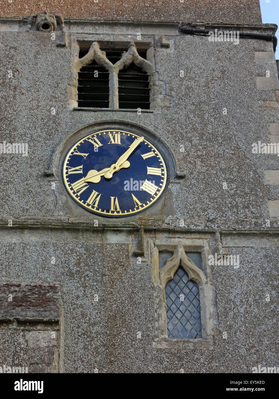 East Ilsley,village,parish,Berkshire,Mary,Saint,Time,fingers,stone,A34,United Kingdom,highest,grade,grade II,listed,church,medieval,stone,render,Hildersley,West Ilsley,Norman,English,style,chancel,religion,religious,place,of,worship,Clock,face,England,UK,United Kingdom,blue,gold,golden,window,GoTonySmith,Buy Pictures of,Buy Images Of