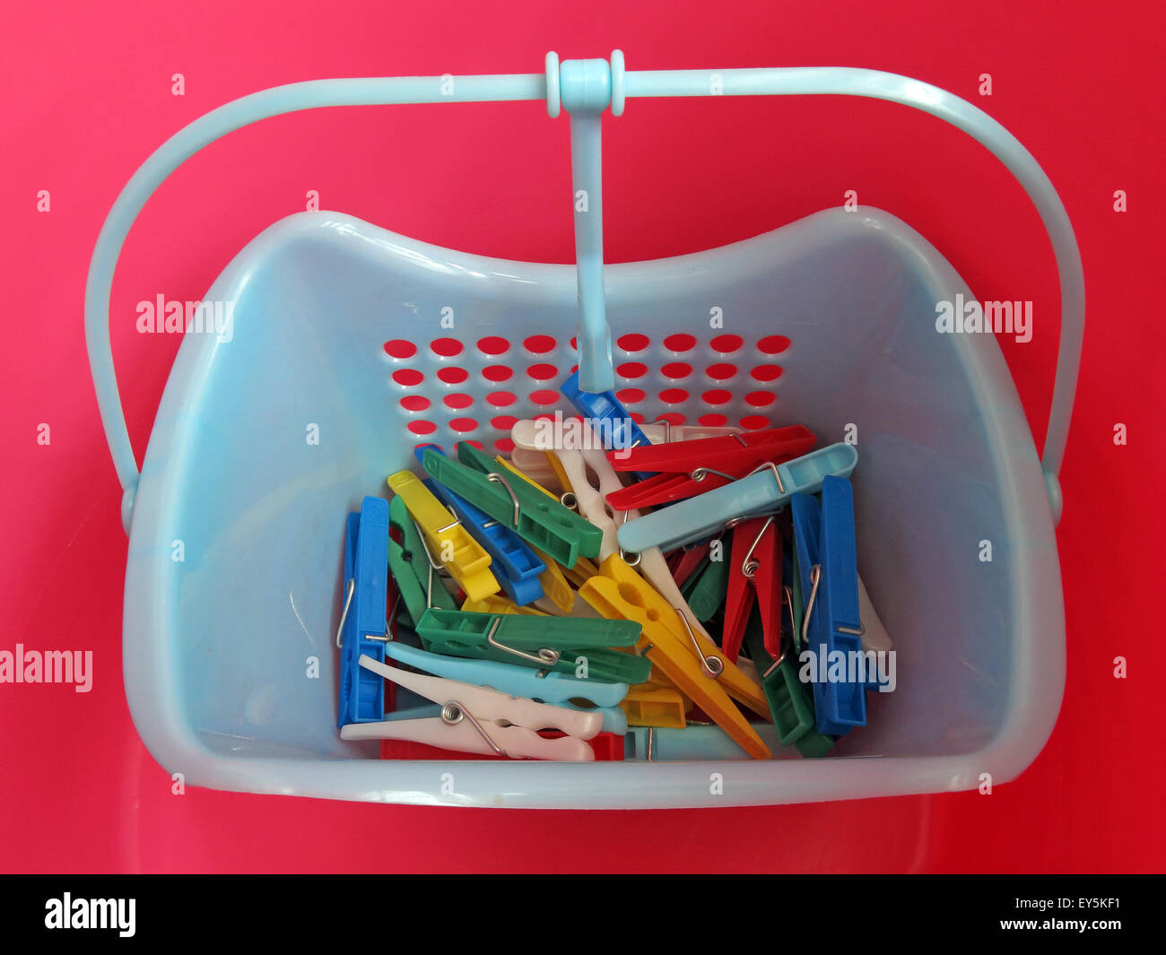Brighter,Wash,washer,day,clothing,peg,washingline,in,blue,yellow,green,basket,with,handle,clip,clips,machine,dry,drying,dryer,white,GoTonySmith,Buy Pictures of,Buy Images Of